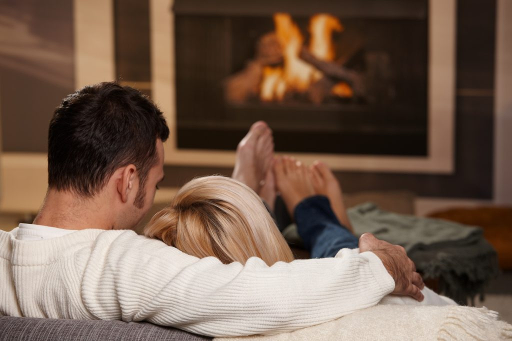 Couple sitting at fireplace
